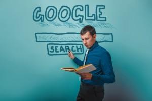 Man Pointing to Google