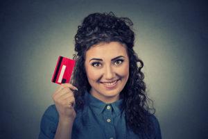 A Woman Holding a Loyalty Reward Card