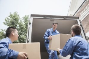 Men moving boxes
