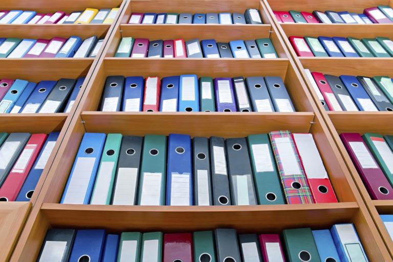 File folders arranged on the shelf