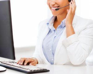 A customer service representative assisting a client inquiry over the phone