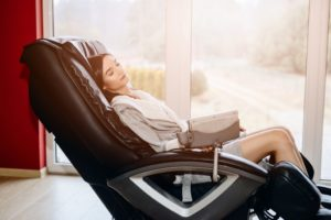 A woman relaxing in a massage chair
