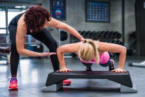 a woman doing push-ups