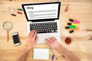 a man writing a blog