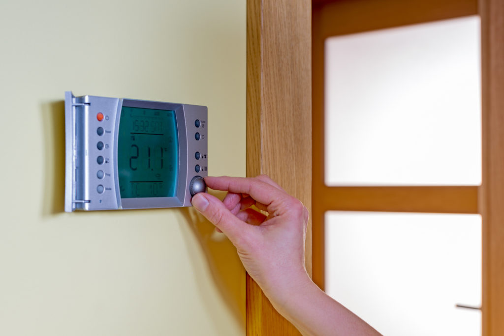 Homeowner configuring their home's temperature