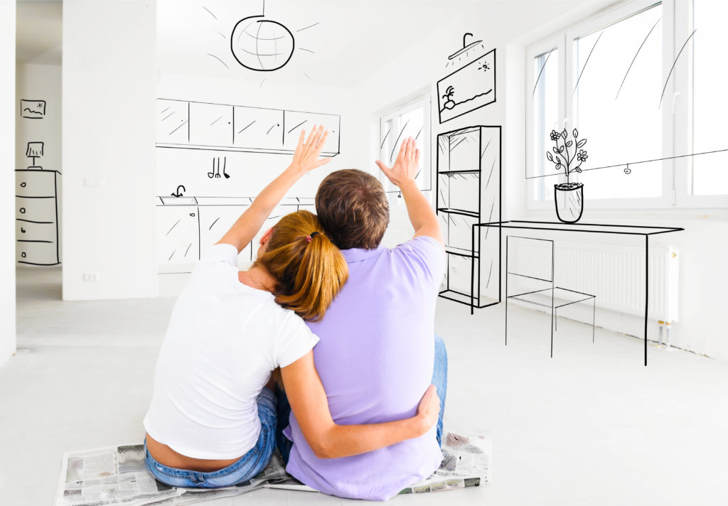 Couple deciding the locations of the furniture