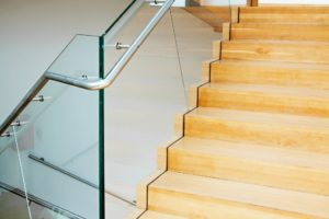 Wooden staircase with glass rail