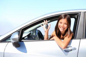 a girl renting a car