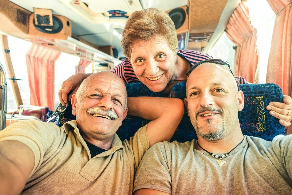 Man travelling with his parents