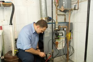 A professional working on a furnace repair
