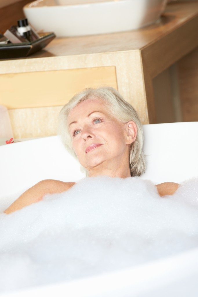 elderly woman in a tub