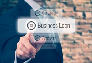 Businessman Pressing Business Loan Button
