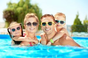 Family swimming in a water park