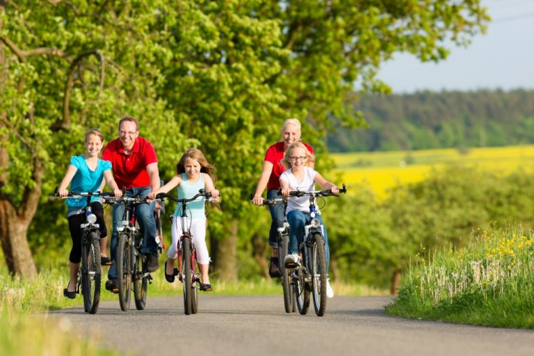 Family riding their bikes