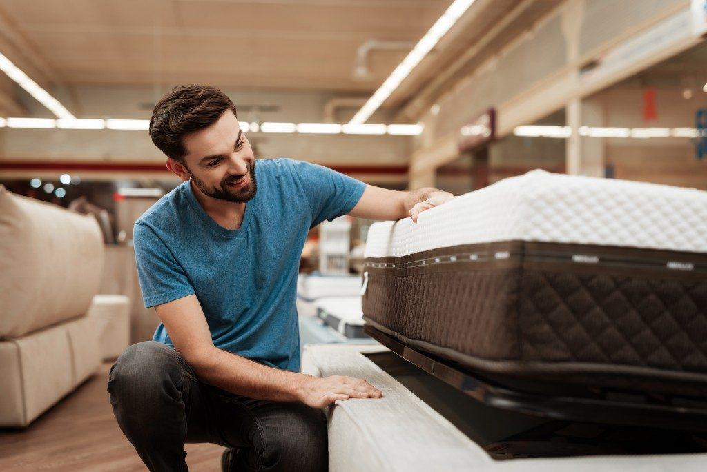 a man shopping for a mattress