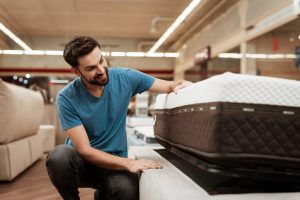 a man shopping for a mattress