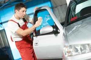 Man cleaning the car window