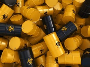 Yellow and black hazardous barrels