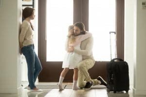 Daughter hugging his leaving dad