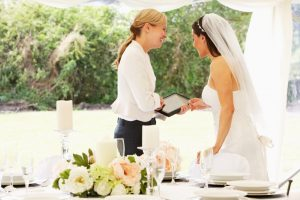 a wedding planner talking to a bride