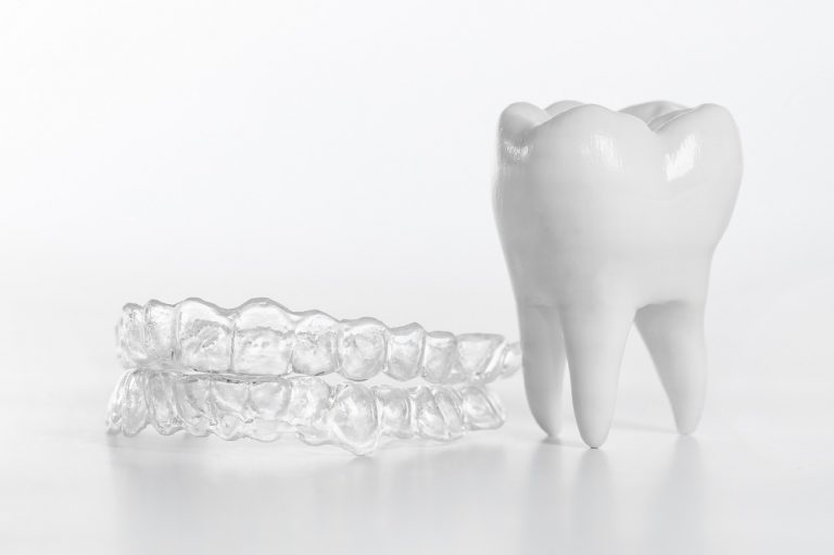 clear braces and a tooth model