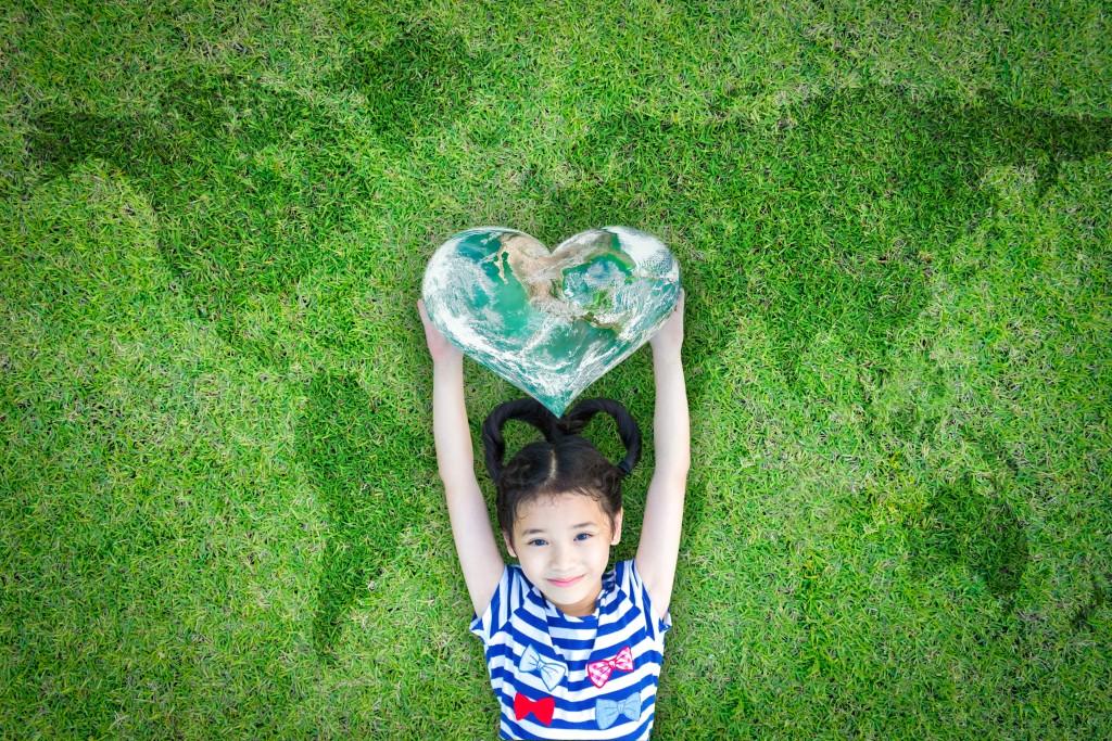 Little girl holding a heart-shaped map