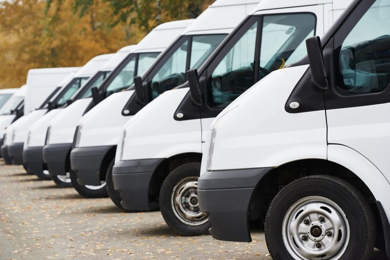 Lined up white sprinter vans