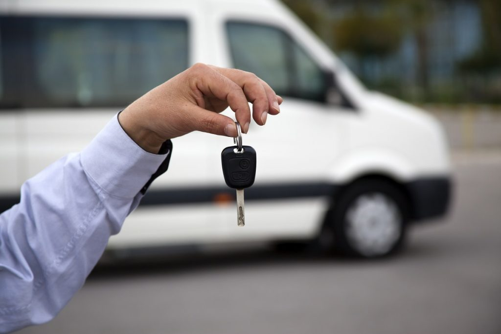 Man holding the sprinter van's key