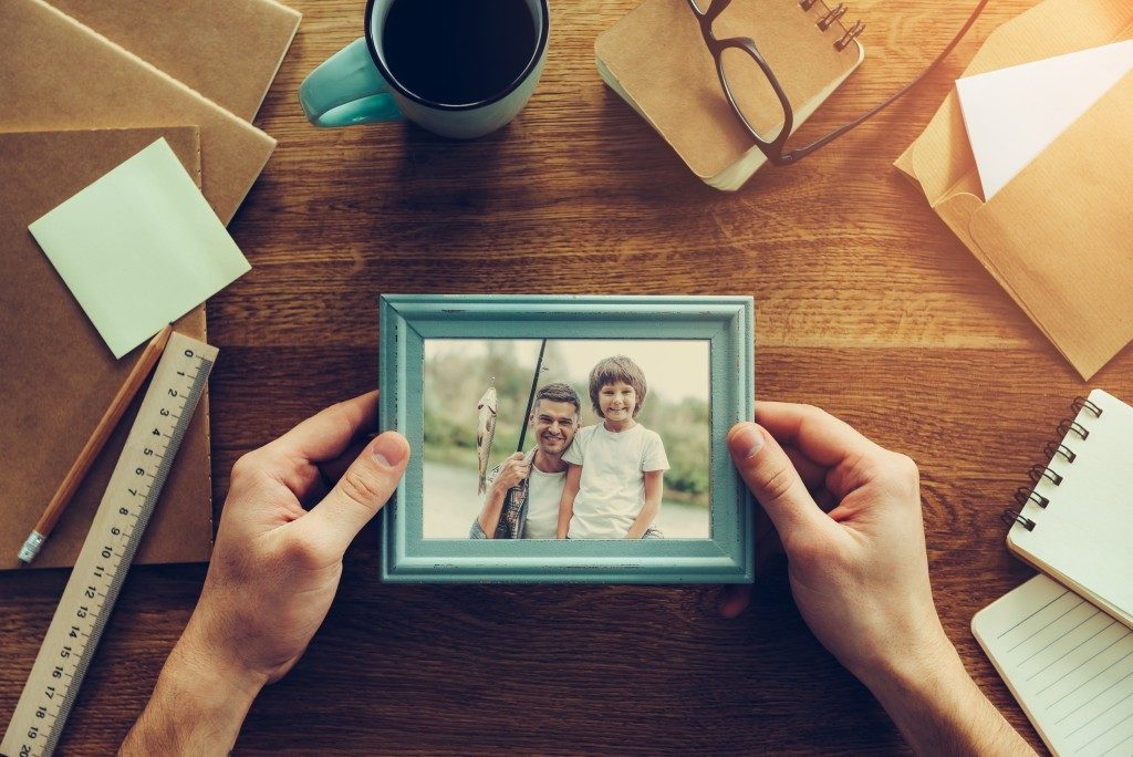 Dad and his son's photograph in a frame