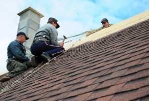 Contractors fixing the roof