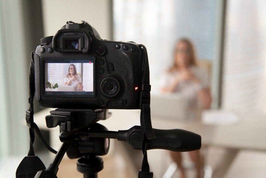 woman shooting a vlog
