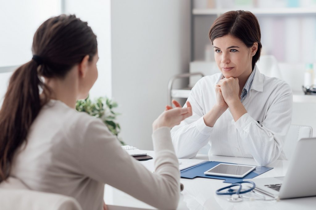Woman discussing with her doctor