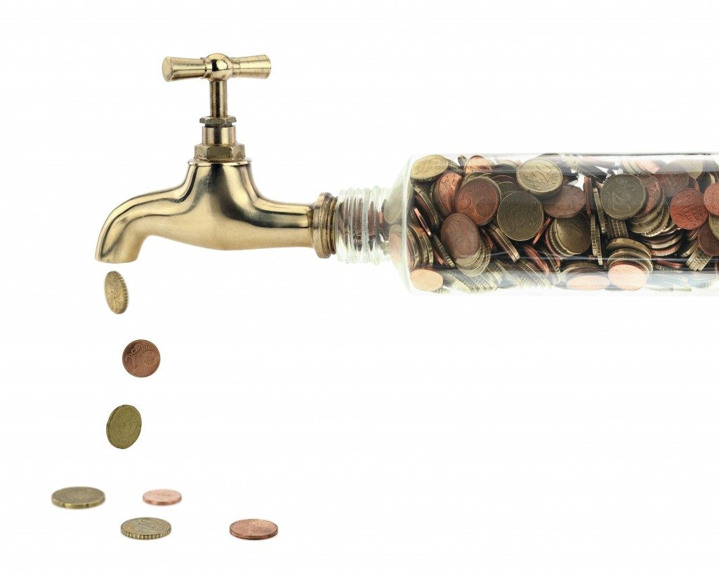 a faucet containing coins