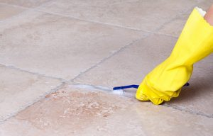 Brushing the grout lines