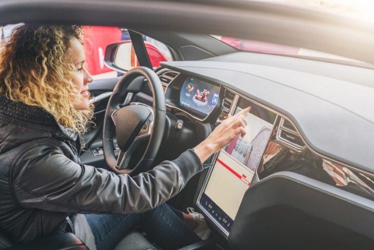 Woman controlling her navigation system