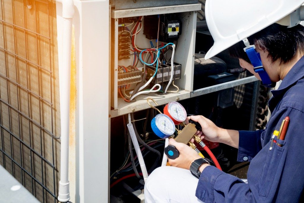 plumber checking heating and cooling system