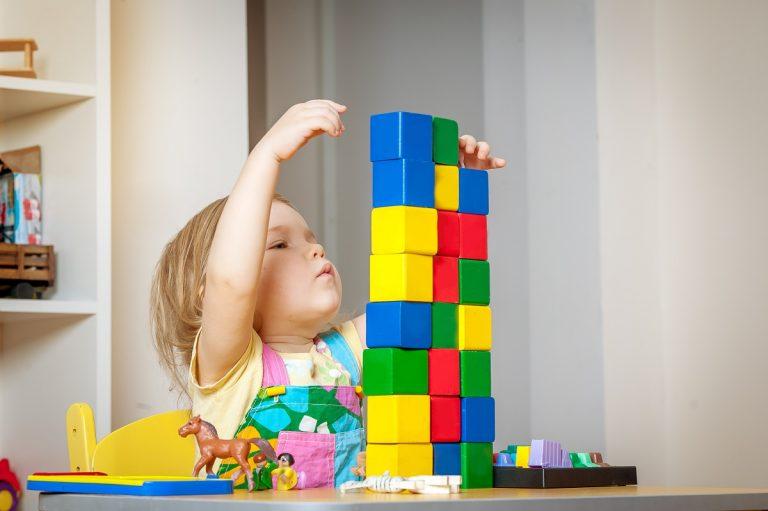 toddler playing block toys