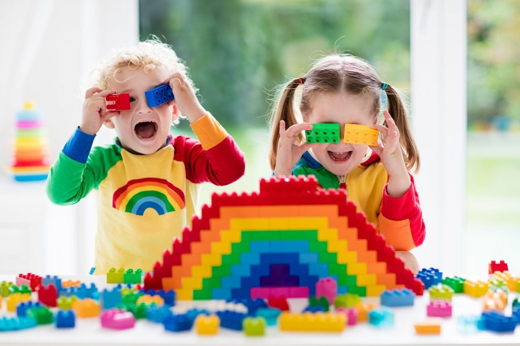 two kids playing lego