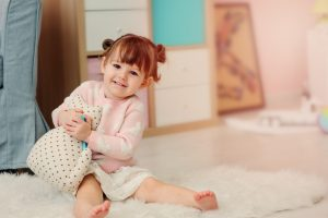 baby girl in cute pigtails and clothes