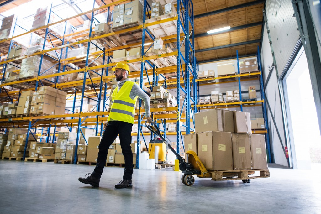 man sorting packages at a warehouse