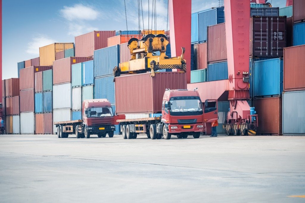industrial crane loading containers in a cargo freight truck