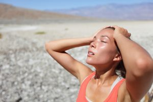 dehydrated woman under the sun