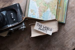 Travel concept with vintage camera and map