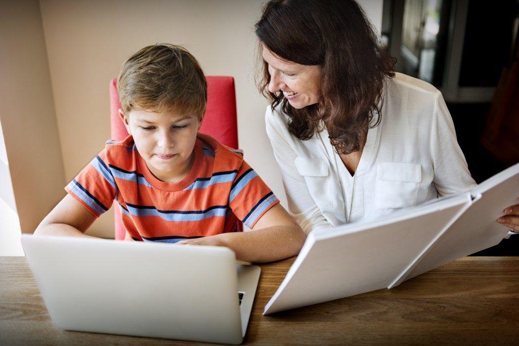 teacher tutoring a student