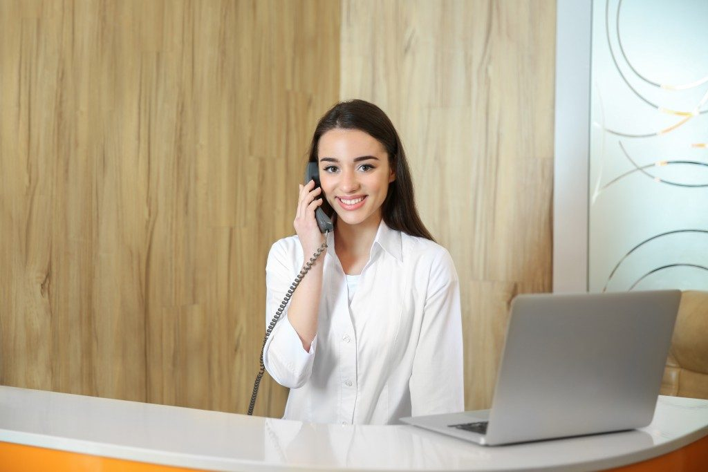 receptionist making a call