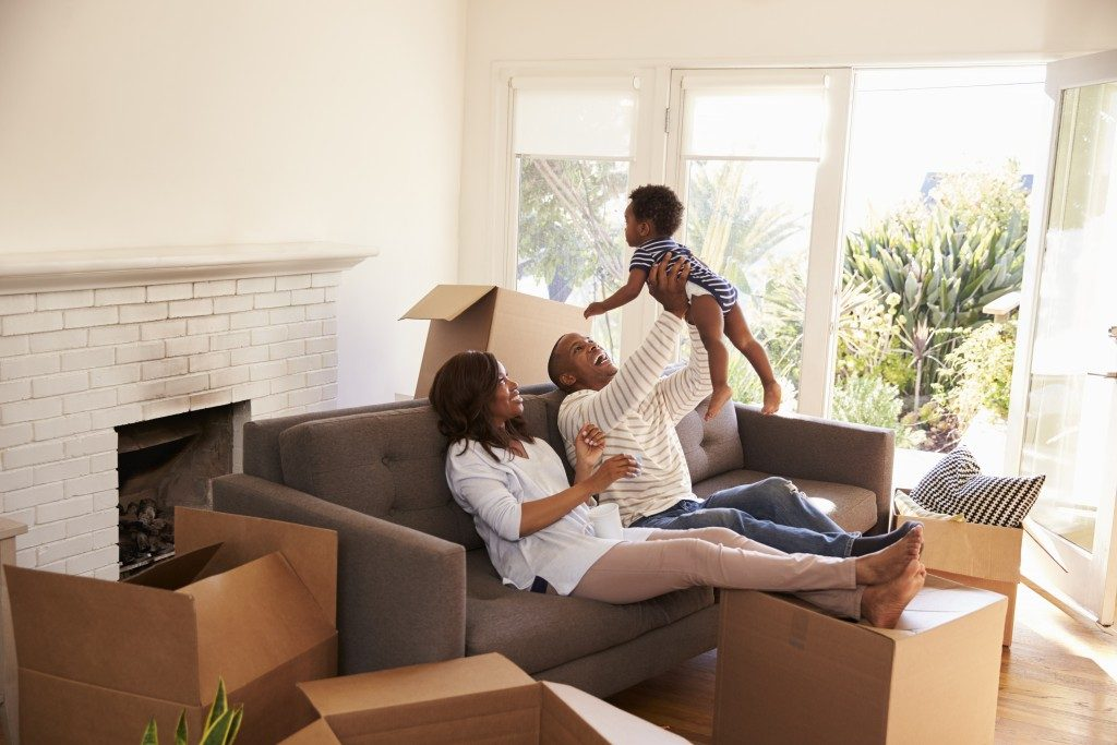 couple with their son in their new house