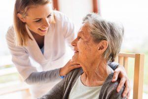 nurse taking care of an elder woman