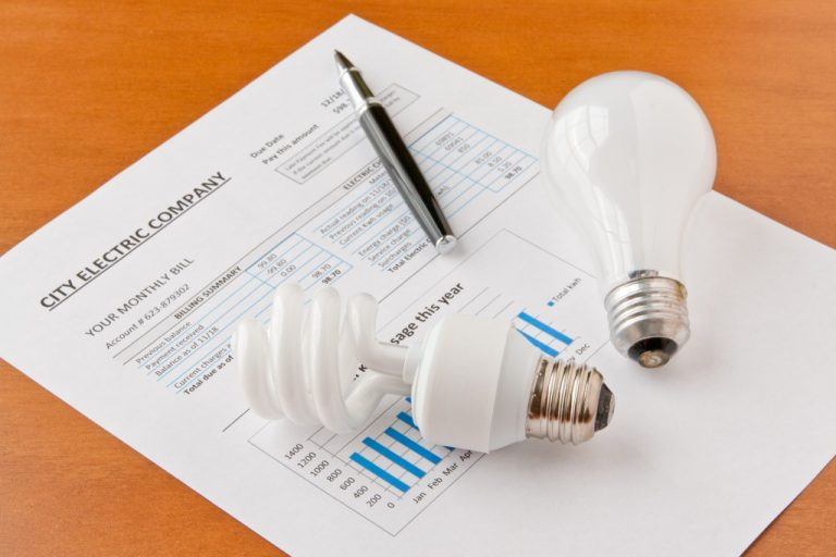 electric bill and lightbulbs