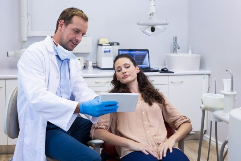 dentist explaining something to his patient