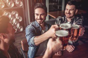 friends drinking at a pub